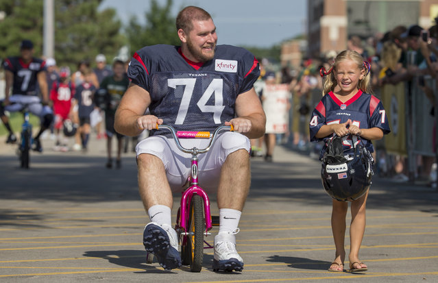 Houston Texans' Max Scharping rides a bike to a joint NFL football practice between the Texans and the Green Bay Packers Monday, August 5, 2019, in Green Bay, Wis. (Photo by Mike Roemer/AP Photo)