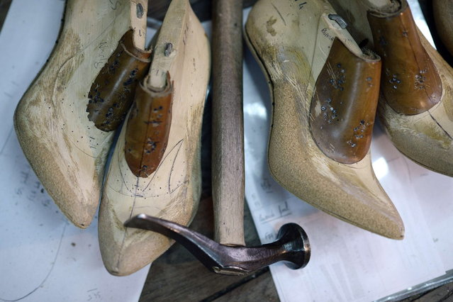"""This picture taken on April 22, 2014 in Paris, shows shoe forms in the workshop of the """"Maison Clairvoy"""". Since 1945, the """"Maison Clairvoy"""" is specialised in the creation of luxury shoes and started in 1960 a collaboration with the famous Moulin Rouge to create boots and shoes for French Cancan dancers. (Photo by Franck Fife/AFP Photo)"""