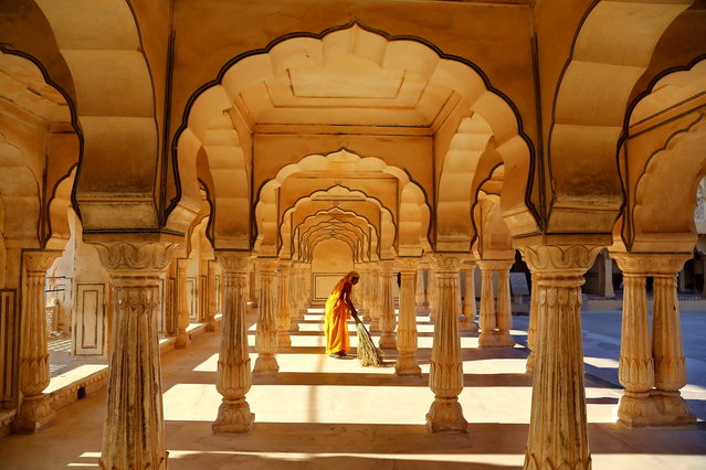 """Impressive Architecture of India"". Very impressive architecture attract me...when a women was sweeping the floor, I took the picture. Photo location: Jaipur, India. (Photo and caption by Raymond Liu/National Geographic Photo Contest)"