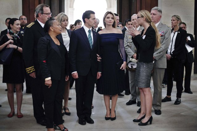 Mexico's President Enrique Pena Nieto (C), Mexico's First Lady Angelica Rivera (2ndR) and French Justice Minister Christiane Taubira (L) visit the Hotel National des Invalides during a welcoming ceremony in Paris, France, July 13, 2015. Mexican President Enrique Pena Nieto starts a state visit to France. (Photo by Thibault Camus/Reuters)