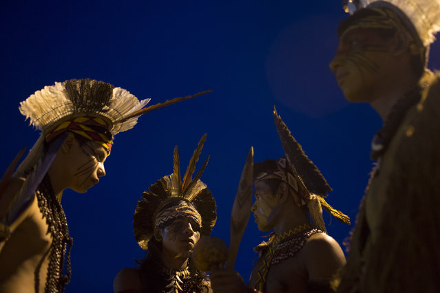 Pataxo Indians gather during the indigenous games in Cuiaba, Brazil, Tuesday, November 12, 2013. Around 1,600 Indians from 48 tribes are celebrating Brazil's indigenous cultures during the 12th edition of the Games of the Indigenous People, which runs until Nov. 16. (Photo by Felipe Dana/AP Photo)