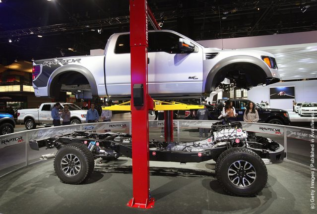 Ford displays the drive train of the  F150 Raptor SVT truck during the media preview of the Chicago Auto Show