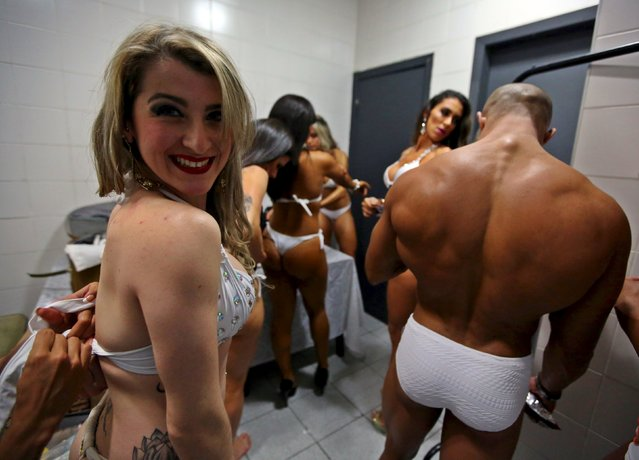 Competitors prepare backstage before the 2015 Brazil Miss and Mister Fitness contest in Sao Paulo, Brazil, June 18, 2015. (Photo by Paulo Whitaker/Reuters)