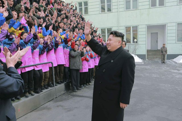 North Korean leader Kim Jong Un waves to a crowd as he provides field guidance to the Ryuwon Shoes Factory in this undated photo released by North Korea's Korean Central News Agency (KCNA) in Pyongyang January 21, 2015. (Photo by Reuters/KCNA)