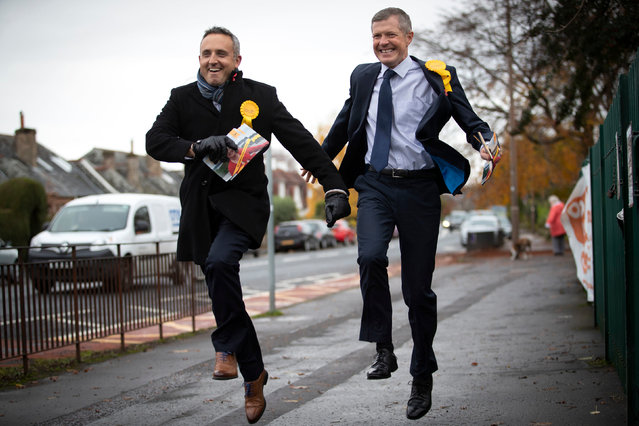 Scottish Liberal Democrat leader Willie Rennie (right) and party General Election campaign chairman Alex Cole-Hamilton on the General Election campaign trail in Blackhall, Edinburgh on November 5, 2019. (Photo by Jane Barlow/PA Images via Getty Images)