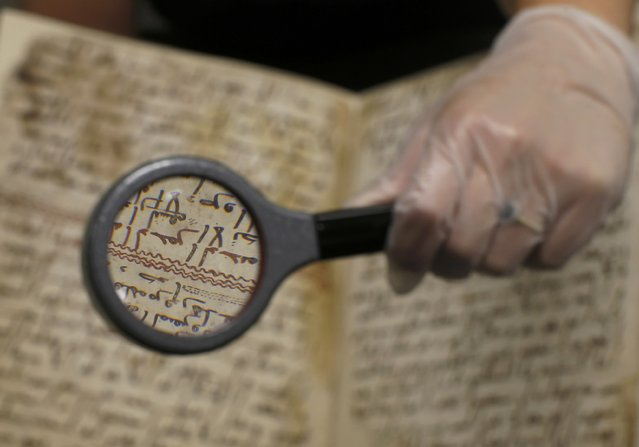 A detail of a fragment of a Koran manuscript is seen through a magnifying glass in the library at the University of Birmingham in Britain July 22, 2015. (Photo by Peter Nicholls/Reuters)