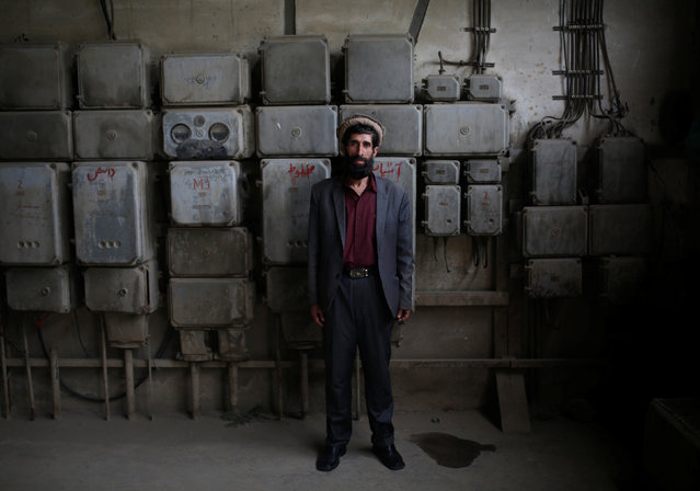 Fazil Haq, 50, an employee at the Jabal Saraj cement factory, poses for a photograph in Jabal Saraj, north of Kabul, Afghanistan April 19, 2016. (Photo by Ahmad Masood/Reuters)