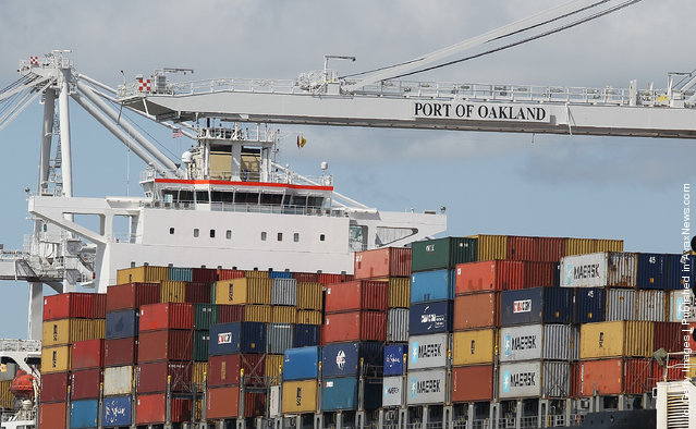Shipping containers are seen on a container ship that is docked at the Port of Oakland on March 22, 2012, in Oakland, California