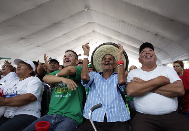 Mexican soccer fans react while watching a large screen broadcasting the 2014 World Cup soccer match between Mexico and Cameroon, in downtown Monterrey June 13, 2014. (Photo by Daniel Becerril/Reuters)