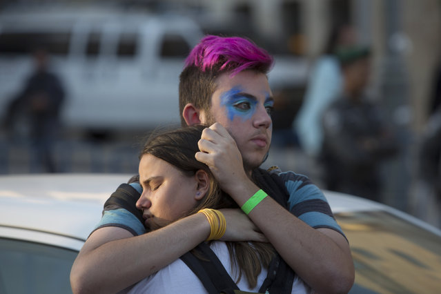 People react after an ultra-Orthodox Jew attacked people with a knife during a Gay Pride parade Thursday, July 30, 2015 in central Jerusalem. (Photo by Sebastian Scheiner/AP Photo)