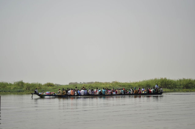 In this photo taken on Sunday, March 1, 2015, a boat carries civilians across the White Nile between Upper Nile state capital Malakal and the village of Wau Shilluk, in South Sudan. Thousands of civilians in South Sudan's Upper Nile state face starvation after the government blocked aid groups from using the Nile River to deliver relief food, aid agencies said Friday, July 31, 2015. (Photo by Jason Patinki/AP Photo)