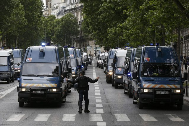 French gendarme vehicules are parked near the Invalides square during a demonstration in Paris as part of nationwide protests against plans to reform French labour laws, France, June 14, 2016. (Photo by Jacky Naegelen/Reuters)