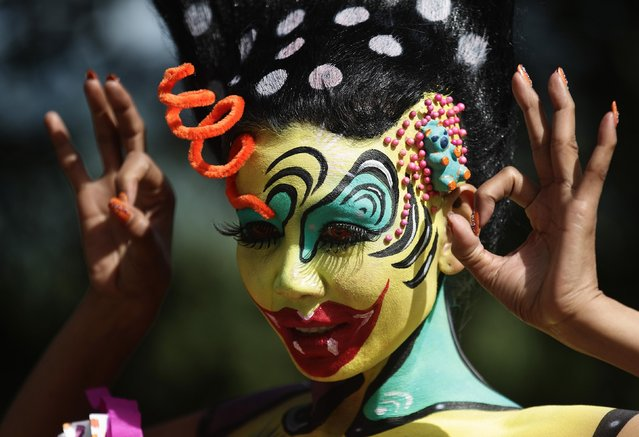A model poses during the annual World Bodypainting Festival in Poertschach July 4, 2014. (Photo by Heinz-Peter Bader/Reuters)