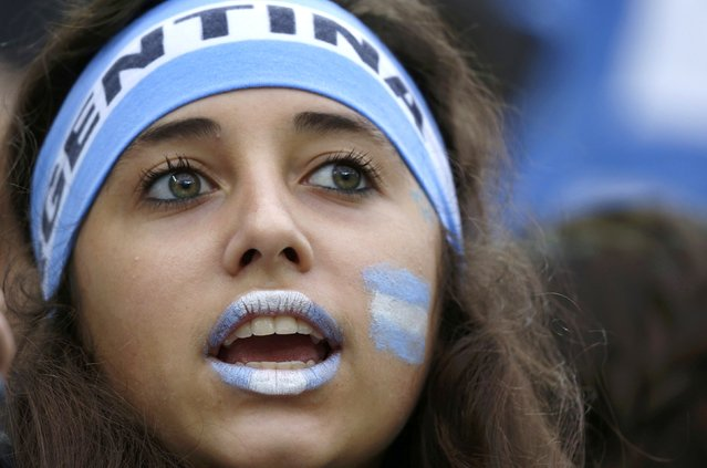 An Argentine fan waits for the start of the 2014 World Cup semi-finals between the Netherlands and Argentina at the Corinthians arena in Sao Paulo July 9, 2014. (Photo by Sergio Moraes/Reuters)