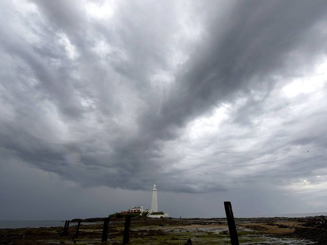 A storm over St Mary's Lighthouse in Northumberland, on Jule 8, 2014. (Photo by Owen Humphreys/PA Wire)