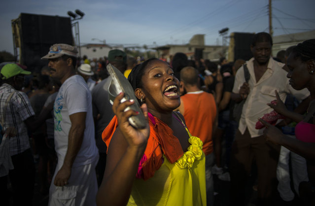 "In this July 27, 2015 photo, a woman sings and dances during a carnival concert in Santiago. ""The city and the region have much to offer. It's just a question of time before tourism in Santiago starts growing"", said Tom Popper, head of Insight Cuba, one of the largest operators of U.S. tours to Cuba. (Photo by Ramon Espinosa/AP Photo)"
