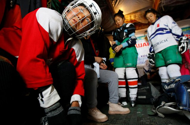 Members of Kyrgyzstan's first female hockey team prepare in a dressing room before a training session in the village of Otradnoye, Kyrgyzstan on February 4, 2020. As the only female hockey team in the country, the group hone their skills and train with male hockey teams. Despite not everyone in the village initially approving of women playing hockey, especially their worried parents, the team is now a firm fixture in the community. (Photo by Vladimir Pirogov/Reuters)