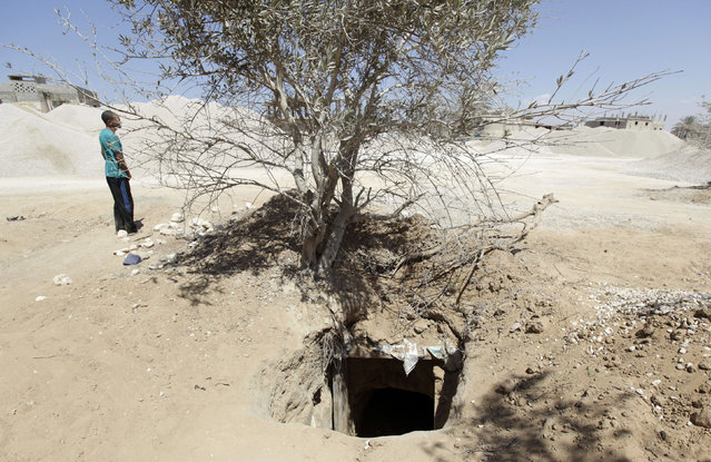 A man walks near a tunnel linking Egypt and the Gaza Strip, at Rafah city, about 350 km (217 miles) northeast of Cairo August 9, 2012. (Photo by Mohamed Abd El Ghany/Reuters)
