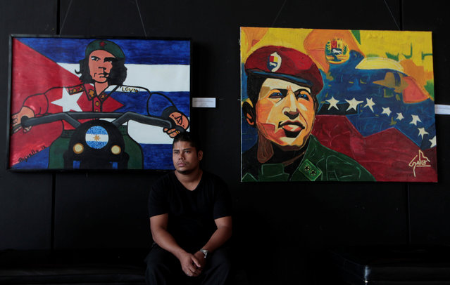 "A man sits in front of pictures of revolutionary hero Ernesto ""Che"" Guevara (R) and late Venezuelan President Hugo Chave at the National Theatre Ruben Dario in Managua, Nicaragua July 6, 2016. (Photo by Oswaldo Rivas/Reuters)"