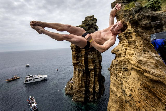 Alain Kohl of Luxembourg dives from the 28 meter platform during the third stop of the Red Bull Cliff Diving World Series, in Islet Vila Franca do Campo, Azores, Portugal on July 21, 2012. (Photo by Dean Treml via Romina Amato/Red Bull)
