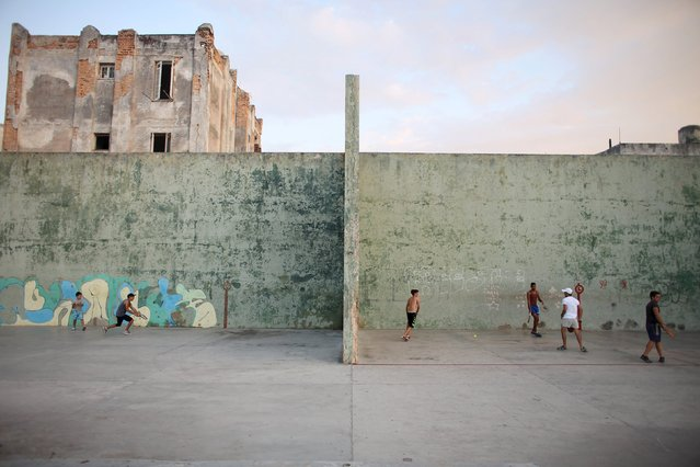Youths play in a park in Havana, February 22, 2015. (Photo by Alexandre Meneghini/Reuters)