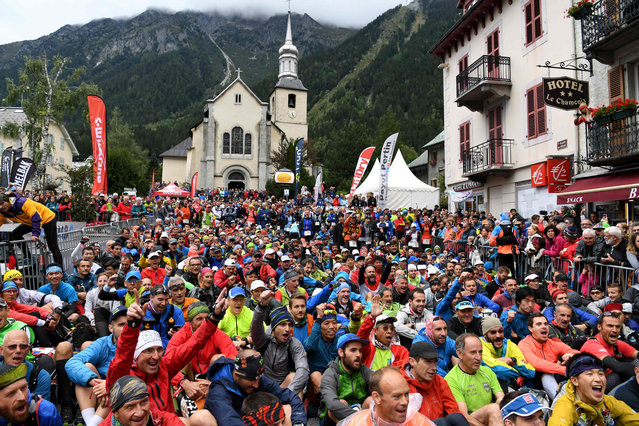 2300 runners wait for the start of the 170 km Mount Blanc Ultra Trail (UTMB) race around the Mont- Blanc crossing France, Italy and Swiss, on September 1, 2017 in Chamonix. (Photo by Jean-Pierre Clatot/AFP Photo)