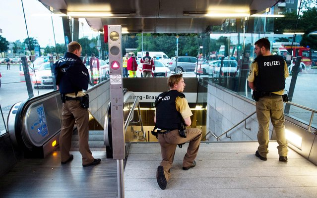 Police secures the entrance to a subway station near a shopping mall where a shooting took place on July 22, 2016 in Munich. Several people were killed on Friday in a shooting rampage by a lone gunman in a Munich shopping centre, media reports said. (Photo by Lukas Schulze/AFP Photo/DPA)