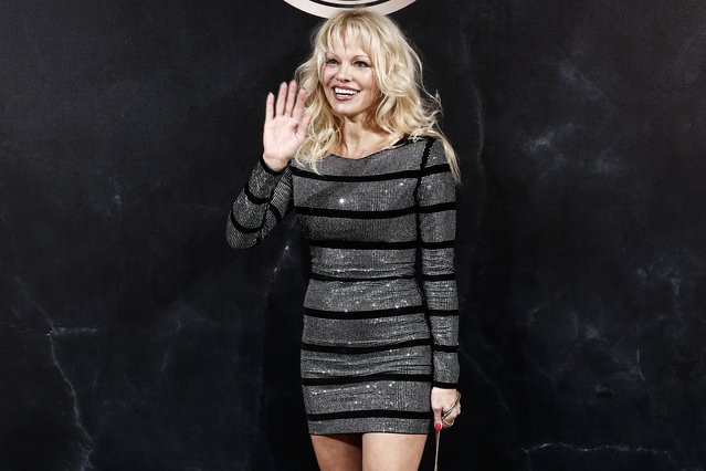 Pamela Anderson poses during a photocall for the L'Oreal Balmain party during the ready-to-wear fashion week in Paris, France, Thursday, September 28, 2017. (Photo by Kamil Zihnioglu/AP Photo)