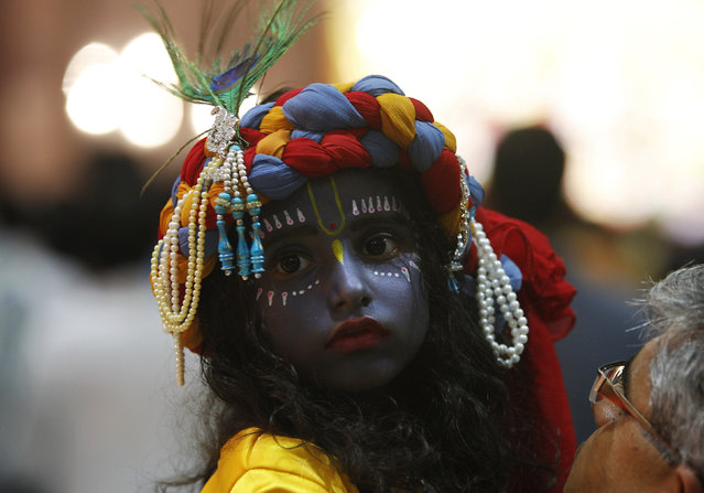 A child dressed as Lord Krishna attends a fancy dress competition at a temple during celebrations before the Janmashtami festival in Chandigarh August 16, 2014. (Photo by Ajay Verma/Reuters)