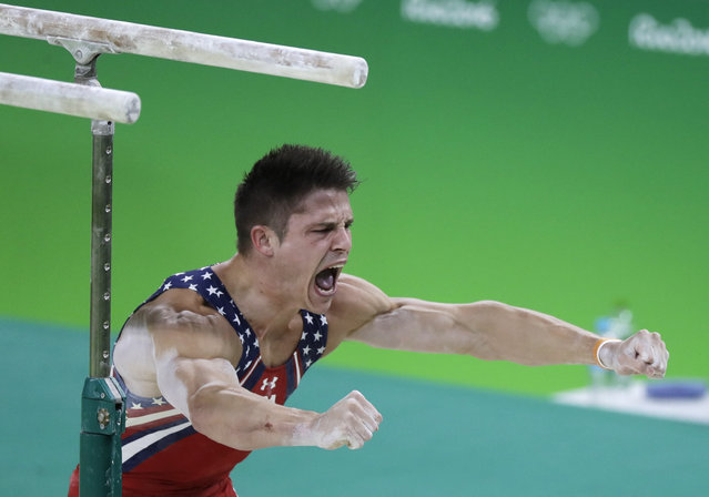 United States' Chris Brooks celebrates after his routine on the parallel bars during the artistic gymnastics men's team final at the 2016 Summer Olympics in Rio de Janeiro, Brazil, Monday, August 8, 2016. (Photo by Rebecca Blackwell/AP Photo)