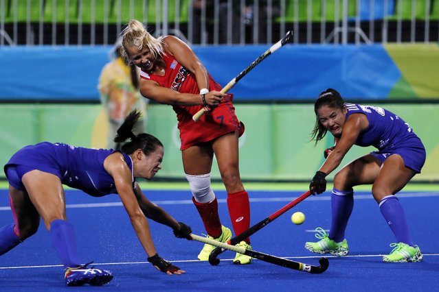 United States' Kelsey Kolojejchick takes a shot past Japan's Mayumi Ono, left, and Motomi Kawamura during a women's field hockey match at the 2016 Summer Olympics in Rio de Janeiro, Brazil, Wednesday, August 10, 2016. (Photo by Dario Lopez-Mills/AP Photo)