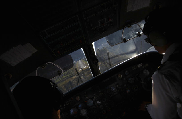 An airstrip is seen through the cockpit of a Dornier aircraft as it approaches to land at Tenzing Hillary Airport, which has a reputation as the world's most dangerous airport in Lukla, approximately 9186 feet above sea level in Solukhumbu district April 25, 2014. (Photo by Navesh Chitrakar/Reuters)