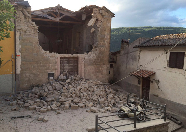 A damaged house is seen following an earthquake in Accumuli di Rieti, central Italy, August 24, 2016. (Photo by Steve Scherer/Reuters)