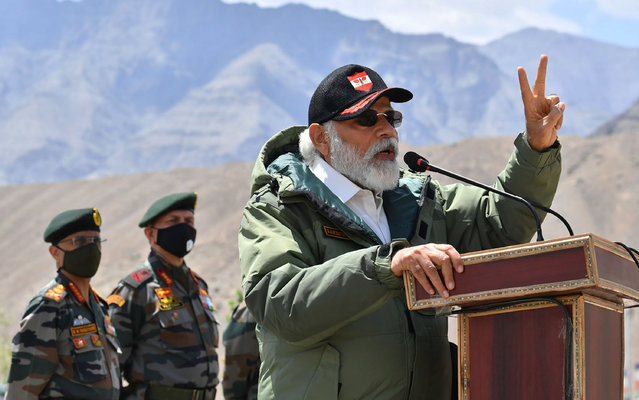 In this handout photo provided by the Press Information Bureau, Indian Prime Minister Narendra Modi adresses soldiers during a visit to Nimu, Ladakh area, India, Friday, July 3, 2020. Modi made an unannounced visit Friday to a military base in remote Ladakh region bordering China where the soldiers of the two countries have been facing off for nearly two months. Modi's visit comes in the backdrop of massive Indian army build-up in Ladakh region following hand-to-hand combat between Indian and Chinese soldiers on June 15 that left 20 Indian soldiers dead and dozens injured, the worst military confrontation in over four decades between the Asian giants. (Photo by Press Information Bureau via AP Photo)