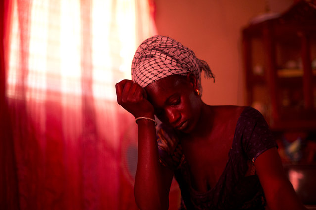 In this October 10, 2013 photo, Aida Diallo, whose ten-year-old son Bamba was killed when a fire struck the Dakar shack where he was sleeping along with other Quranic students, sits in her one-room home in the village of Ndame, Senegal. Bamba's older brother Cheikhou, 13, managed to escape the fire which killed Bamba and three of their cousins. (Photo by Rebecca Blackwell/AP Photo)
