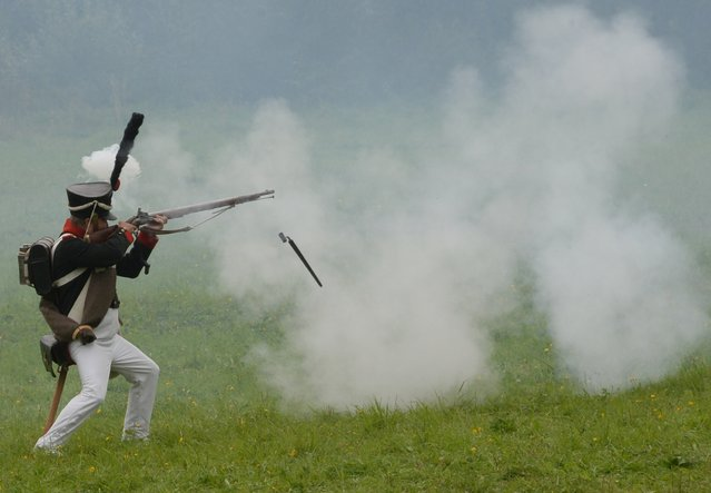 A participant in the Borodino Battle re-enactment during the show at the Borodino Field in the Moscow Region on September 4, 2016. (Photo by Kirill Kallinikov/Sputnik)