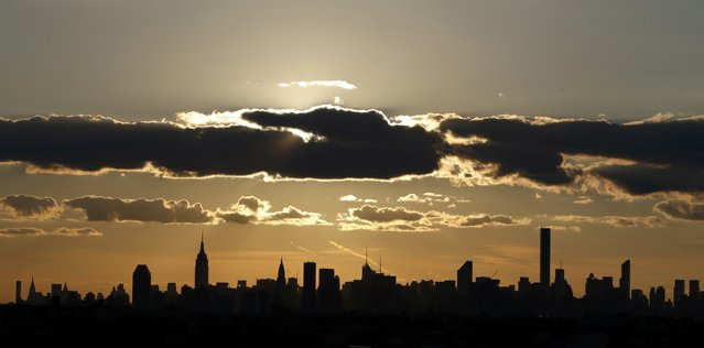 The New York City skyline is seen at sunset during play at the U.S. Open Championships tennis tournament in New York, September 11, 2015. (Photo by Carlo Allegri/Reuters)