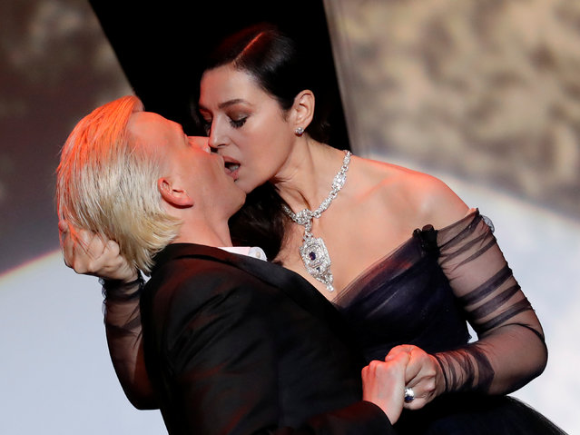 Mistress of Ceremony actress Monica Bellucci kisses actor Alex Lutz on stage at the opening ceremony of the Cannes Film Festival, May 17, 2017. (Photo by Eric Gaillard/Reuters)