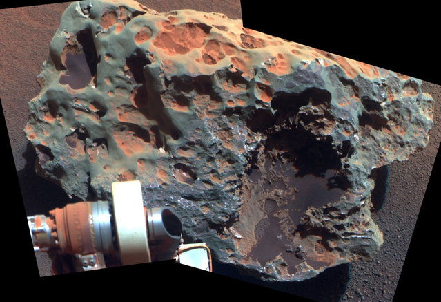 "A view of a rock called ""Block Island"", the largest meteorite yet found on Mars, comes from the panoramic camera on Opportunity. Analysis of Block Island's composition using the rover's alpha particle X-ray spectrometer confirmed that it is rich in iron and nickel. The rock is about 60 centimeters (2 feet) across. (Photo by AP Photo/NASA/JPL-Caltech/Cornell University/The Atlantic)"