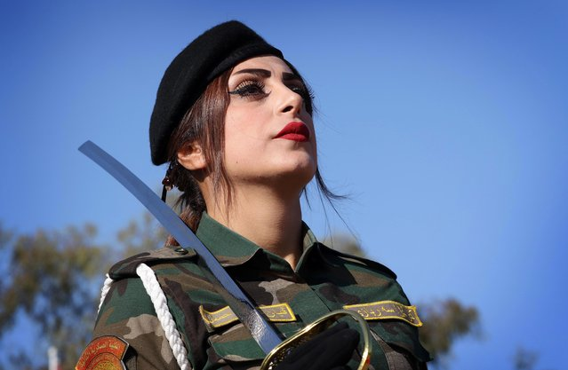 An Iraqi Kurdish Peshmerga takes part in a graduation ceremony at the Zakho military academy in the Iraqi Kurdish town of Zakho, some 500 kilometres north of Baghdad, on January 30, 2018. (Photo by Safin Hamed/AFP Photo)
