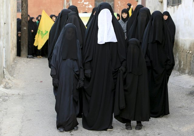 Muslim Shi'ite women and girls carry Hezbollah flags as they take part in a march organised by Hezbollah during a re-enactment of the battle of Kerbala during a mourning process, ahead of the day of Ashoura, in Saksakieh village, southern Lebanon, October 18, 2015. Ashoura, the most important day in the Shi'ite calendar, commemorates the death of Imam Hussein, grandson of the Prophet Mohammad, in the 7th century battle of Kerbala. (Photo by Ali Hashisho/Reuters)