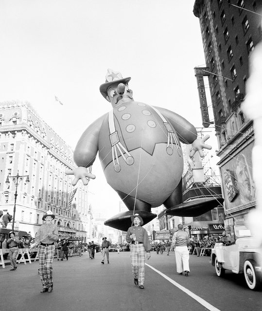 A huge balloon in the form of comic fireman floats over Broadway during the annual Macy's Thanksgiving Day Parade in New York, November 25, 1948. (Photo by John Rooney/AP Photo)
