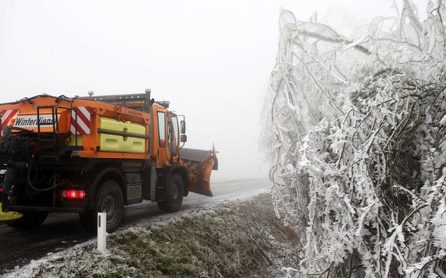 A snow plough passes ice covered trees near Amstall in northern Austria, December 2, 2014. (Photo by Heinz-Peter Bader/Reuters)