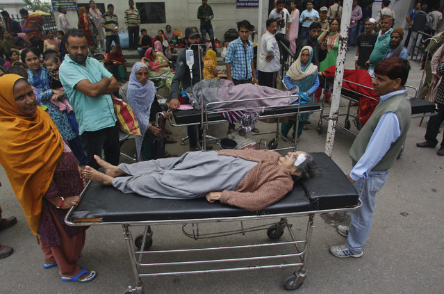 Patients who were shifted outdoors at the government medical college hospital after a strong tremor was felt in Jammu, India, Monday, October 26, 2015. A strong earthquake in northern Afghanistan was felt across much of South Asia on Monday, shaking buildings from Kabul to Delhi and cutting power and communications in some areas. (Photo by Channi Anand/AP Photo)