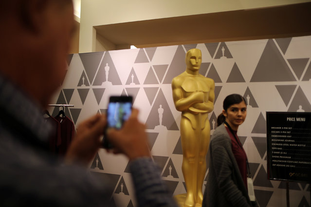 An Oscar statue is seen in a souvenir shop at the Dolby Theatre during preparations for the Oscars in Hollywood, Los Angeles, California, U.S. February 28, 2018. (Photo by Lucy Nicholson/Reuters)