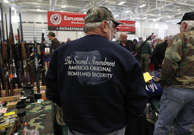 A sweatshirt states the position of many gun supporters at Washington County Fairgrounds Gun Show that drew thousands of people over the weekend, on March 22, 2013. (Photo by Gary Porter)