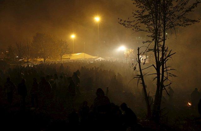 Migrants wait to cross the Slovenia-Austria border in Sentilj, Slovenia, October 27, 2015. (Photo by Srdjan Zivulovic/Reuters)