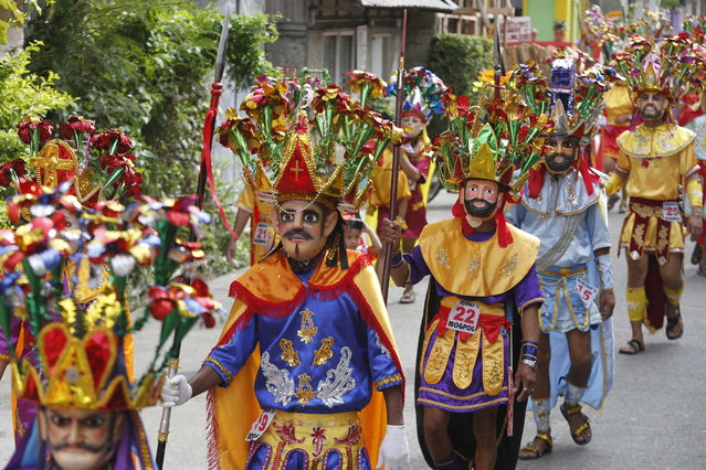 """Penitents take part in a procession for the Moriones Festival during Holy Week in Mogpog town on Marinduque island, central Philippines March 27, 2013. During the annual festival, masked and costumed penitents called """"Moriones"""" dress in attire that is the local interpretation of what Roman soldiers wore during biblical times. Holy Week is celebrated in many Christian traditions during the week before Easter. (Photo by Erik De Castro/Reuters)"""