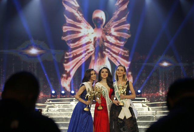 Newly crowned Vietnam's Nguyen Huong Giang (C), with first runner up Australia's Jacqueline (R) and second runner up Thailand's Rinrada Thurapan, (L) pose for photos after the annual transgender beauty contest of Miss International Queen 2018 at Pattaya city, in Chonburi province, Thailand, 09 March 2018. (Photo by Narong Sangnak/EPA/EFE)