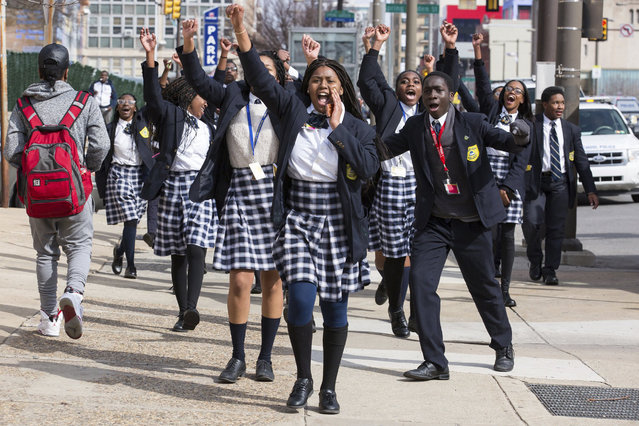 Multicultural Academy Charter School student Kayla Brooks, center, walks along with other students towards the school district's building as they participate in a walkout to protest gun violence, Wednesday, March 14, 2018, in Philadelphia, one month after the deadly shooting inside a high school in Parkland, Fla. (Photo by The Philadelphia Inquirer via AP Photo)